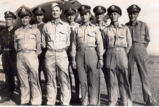 (Nine pilots during the North Africa campaign.) L-R: Frederick J. Bitten, Marlow J. Leikness (ACE), Carroll S. Knott (ACE), Richard E. Decker, Anthony Evans (ACE), William J. Gregory, Harold T. Harper, Lloyd K. DeMoss, Wayne M. Manlove.