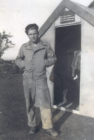 Crew Chief Michael Whiteford is shown in front of the hut he built with scrounged pieces of wood. (It looks good enough to be sold at Home Depot.) He placed it next to where his aircraft was parked for quicker access.