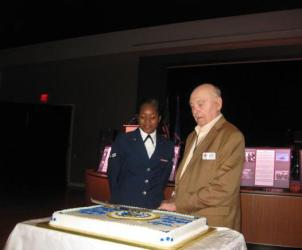 Cutting of the cake at the Air Force Ball, Columbus, MS; the youngest Air Force service member and our own Cliff Bailey who was an original member of the 49th FS in 1941!
