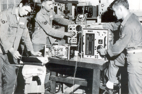 Joe Chatfield, Paul Scoskie, and Tom Morrisey fine tune the radar for an F-86D.