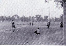 Baseball at Hanscom Field (Not quite Fenway Park) Bob Thomalen coaching at third base Dave Jeffrey on deck