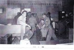 Waiting for C-119 to take us to Yuma (2/4/1956) Dave Jeffrey (left) Dick Gulbransen w/headlock on Ray Fratus Henry Salustro is behind them reading his Boston paper