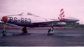 F-84B at Dow AFB, Bangor, ME. Note the red and white squadron color markings on the aircraft.