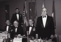 And for making it safely back to earth, a dinner in his honor at a Dining-in. Pictured at the affair below are: Base Chaplain (name unknown); Gen. David Goodrich, Commander, 24th Air Division (standing); Esky Ringdahl (local businessman); Col. (later Lt. Gen.) Brett Dula, Commander, 416th Bomb Wing; and Guest of honor Keith Ferris (standing).