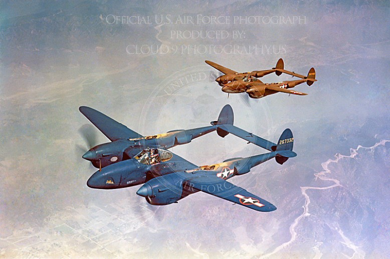 P-38 00004 Two US Army Air Corps in-flight Lockheed P-38 Lightning WWII era fighters, one blue and one olive drab, Official USAF Picture-L
