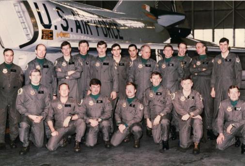 49th FIS Pilots Griffiss AFB (1984-1987) Front row- Cliff Baker, Jon Flaugher, Dick Embry, Grant Bruckmeier, Steve Rogers (Sq/CC), Bobby Armour, George Vida. Back row- Bob Pedka, Buck Lowery, Ron Root, Ed Gerken, Gary Stopa, Harry Baumgarten, John Jannazo, Bill Thomas (Ops Officer), Bob LeTourneau (Loring AFB Det/CC), Jim Parker, Dan Kerecman, Wyman Varnedoe.