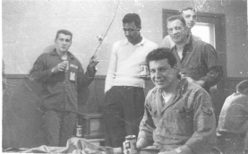 This was not a prayer meeting in the barracks. Seated: Arnie Cohen Standing: Bob Thomalen, Russell Oliver, Ed Roman. Back row: Bill Borus. Remember Schlitz?